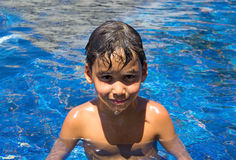 Boy in a swimming pool Stock Image