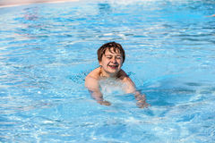 Boy swimming in the pool Stock Images