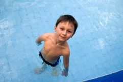 Boy in the swimming-pool Stock Images