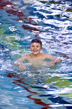 Boy in swimming pool. A smiling boy in a swimming pool