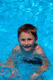 Boy in the swimming-pool.  stock images