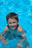 Boy in the swimming-pool.  stock photos