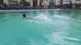 Boy swimming. A boy in swimming pool Royalty Free Stock Images