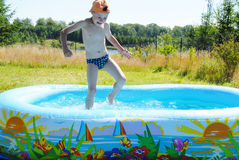 Boy in swimming pool. Royalty Free Stock Photography