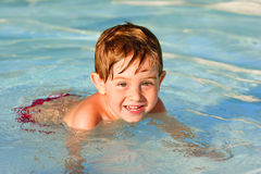 Boy in a swimming pool Stock Photos