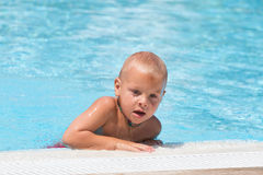 Boy in a swimming pool Stock Images