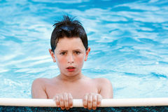 Boy in the swimming pool Stock Photos