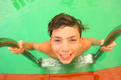 Boy in swimming pool close up portrait. Preteen boy in swimming pool close up portrait Royalty Free Stock Image