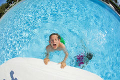 Boy swimming in the pool Stock Photography