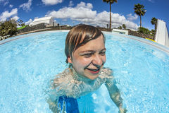 Boy swimming in the pool Stock Photos