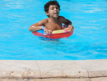 Boy in the Swimming Pool. Egypt, Nov. 23 2014 : Happy people and girls in bikini enjoying bath time in pool, Sharm el-Sheikh Royalty Free Stock Images