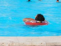 Boy in the Swimming Pool. Egypt, Nov. 23 2014 : Happy people and girls in bikini enjoying bath time in pool, Sharm el-Sheikh Stock Photo