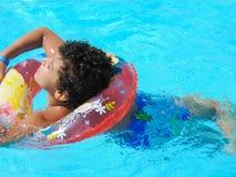 Boy at Swimming Pool. Egypt, Nov. 23 2014 : Happy people and girls in bikini enjoying bath time in pool, Sharm el-Sheikh Royalty Free Stock Photography