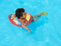 Boy at Swimming Pool. Egypt, Nov. 23 2014 : Happy people and girls in bikini enjoying bath time in pool, Sharm el-Sheikh Stock Photo