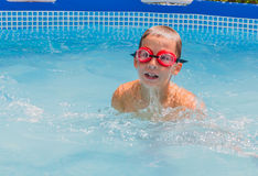 Boy in the swimming pool Stock Images