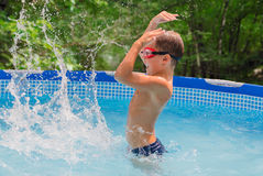 Boy in the swimming pool Royalty Free Stock Images