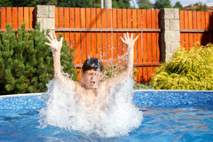 Boy in the swimming pool Stock Photo