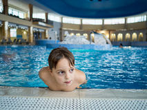 Boy in swimming pool. Little boy having a good time in swimming pool during family holidays stock images