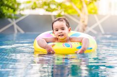 Boy in the swimming pool Stock Photography