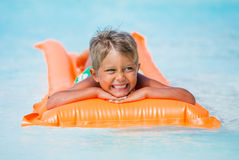Boy at swimming pool Stock Images