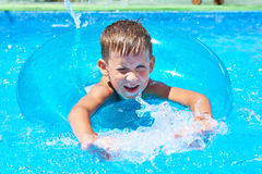 Boy swimming into pool Royalty Free Stock Photography