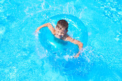 Boy swimming into pool Royalty Free Stock Photo