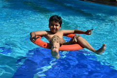 Boy in swimming pool with safety guards Stock Images