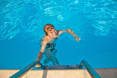 Boy swimming in a pool Royalty Free Stock Photo