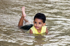 Boy swimming in the river stock photo