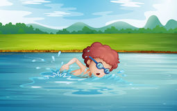 A boy swimming at the river with goggles Stock Images
