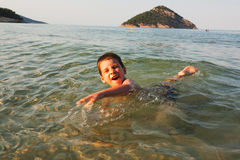 Boy swimming in the sea Royalty Free Stock Photography