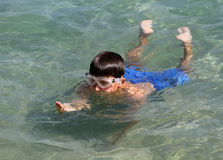 Boy swimming in the sea Stock Images