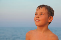 Boy after swimming is on seashore Royalty Free Stock Photography