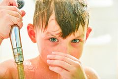 The boy is swimming in the shower.  stock images