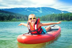 Boy swimming on stand up paddle board.Water sports , active lifestyle. Water sports , active lifestyle.Boy swimming on stand up paddle board royalty free stock images