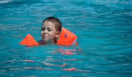 A boy swimming in the swimming pool Stock Photography