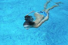 Boy swimming under water Stock Photography