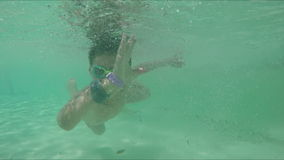 The boy is swimming under the water stock footage