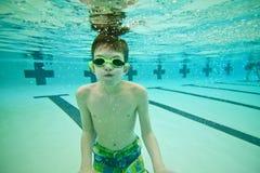 Boy Swimming Underwater Stock Photos