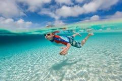 Boy swimming underwater Stock Photo