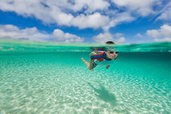 Boy swimming underwater Royalty Free Stock Images