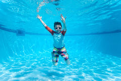 Boy swimming underwater Stock Images