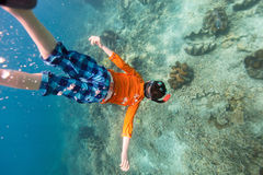 Boy swimming underwater Royalty Free Stock Photo