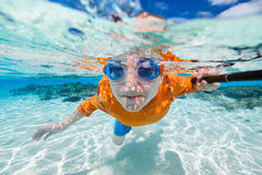 Boy swimming underwater Royalty Free Stock Image