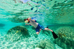 Boy swimming underwater Stock Photos