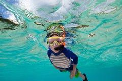 Boy swimming underwater Royalty Free Stock Photos