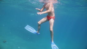 Boy swimming underwater. In sea stock video