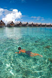 Boy swims on clear crystal ocean. A boy swims on clear crystal ocean fills with coral during vacation Royalty Free Stock Images
