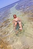 Boy swims on his back Royalty Free Stock Photo