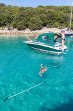 A boy swims near the boat. Royalty Free Stock Images